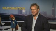 INTERVIEW Hugh Bonneville on growing up with 'Paddington' being nervous about being apart of such an iconic character at 'Paddington' Interviews at...