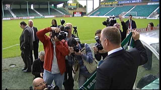 Hughes unveiled as Hibernian manager SCOTLAND Edinburgh Easter Road EXT Shots of Easter Road stadium John Hughes walks out of tunnel Hughes posing...