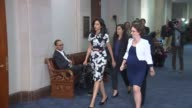 Huma Abedin close aide to presidential candidate Hillary Clinton returns after a break for lunch to continue an interview with staff and members of...
