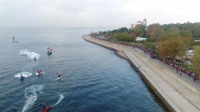 "Human ""chains of respect"" stretching for kilometers are formed as people held hands to mark the 79th anniversary of the death of founder Mustafa..."