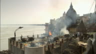 WS PAN Human cremation firing on rooftop of ganga river / Varanasi, Uttar Pradesh, India