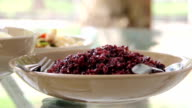 Human eating rice berry with dishes