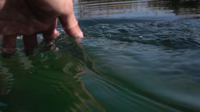 Human hand grabbing water
