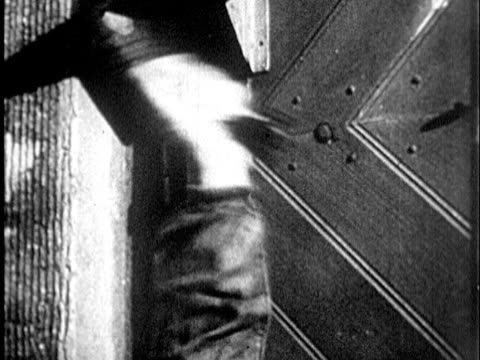 1935 B/W CU Human hand pulling rope ringing bell