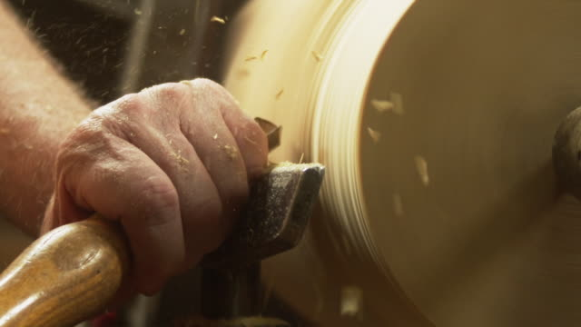 CU SLO MO Human hand shaping wood at workshop / Squamish, British Columbia, Canada