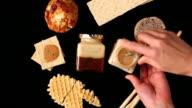 CU Human hand spreading jam on bread and put it down / Seoul, South Korea