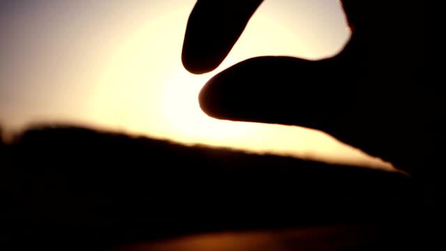 Human hand with light of sun