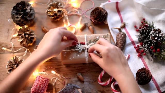 Human Hand Wrapping Christmas Present