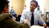 Human resources manager interviews businessman
