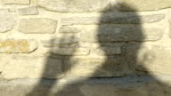 human shadow on a wall counting to five