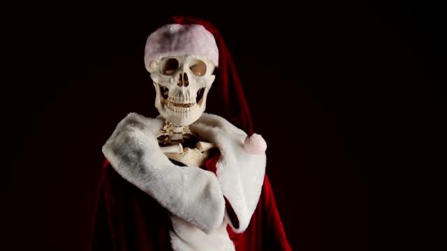 Human skeletal Santa Claus waving