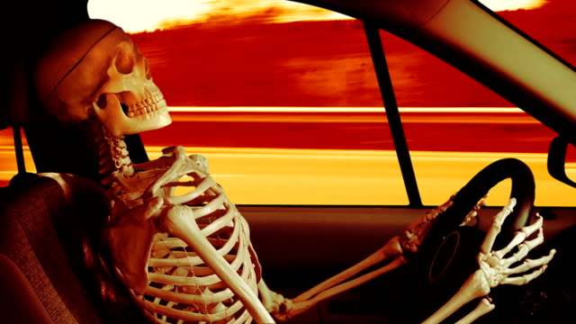 Human skeleton driving a car