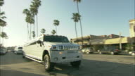 A hummer limo slowly passes by.