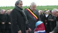 A hundred years after the famous World War I Christmas Truce UEFA chief Michel Platini unveiled a memorial Thursday to the football match British and...