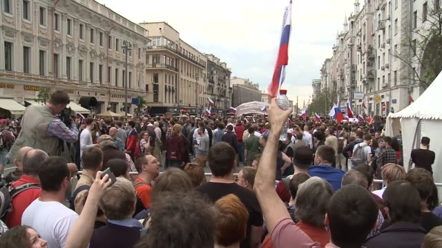 Hundreds arrested in anticorruption protests led by Alexei Navalny High angle shot riot police clashing with protesters DOWN protesters Various shots...