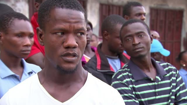 Uncertainty over death toll SIERRA LEONE Freetown EXT Distressed woman crying and singing SOT Distressed man crying and being comforted Vox pop...