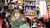 Hundreds march on Philippines Independence Day to protest against China's reclamation and construction activities on islands and reefs in the South...