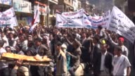 Hundreds march toward the municipality building during a demonstration rally to mark the fourth anniversary of the 2011 revolution beginning of...