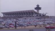 Hundreds of cars filling the parking lot at Dulles Airport in Washington.