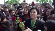 Hundreds of fans mob expremier Yingluck Shinawatra as she arrives at court to give evidence at her negligence trial imploring supporters to vote in a...