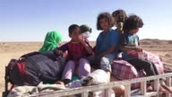 Hundreds of Iraqi families on Monday were fleeing fighting in areas around the town of Hit as Iraqi forces continue their broad offensive to retake...