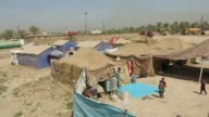 Hundreds of Iraqi families who fled the Anbar province after it was seized by Islamic State group militants found refuge in a camp managed by...