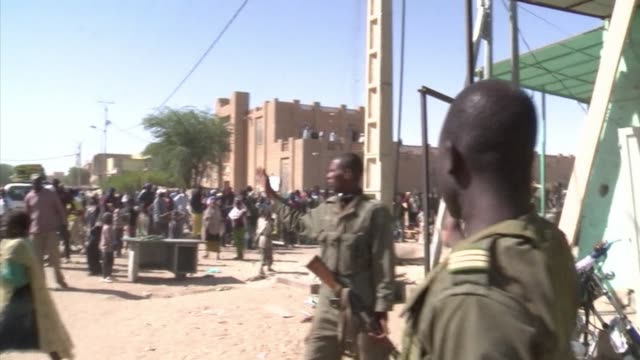 Hundreds of Malians looted stores in Timbuktu on Tuesday saying the shops belonged to Arabs and terrorists linked to the radical Islamists who...
