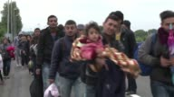 Hundreds of migrants arrived on buses at Terezino Polje on the border between Croatia and Hungary on Sunday before crossing into Hungary on foot with...