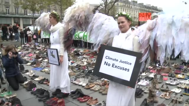 Hundreds of pairs of shoes are left in a Paris square in a silent climate change protest after the government banned all public demonstrations linked...