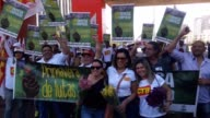 Hundreds of people convened by the Central of Brazil's Workers and the other trade union centrals take part in a demonstration and deliver flowers...