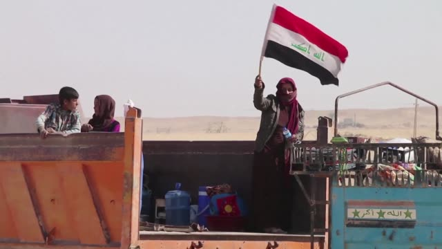 Hundreds of people fled the village of al Obeidi on Wednesday after it was recaptured by Iraqi forces who are battling up to the edge of nearby Al...