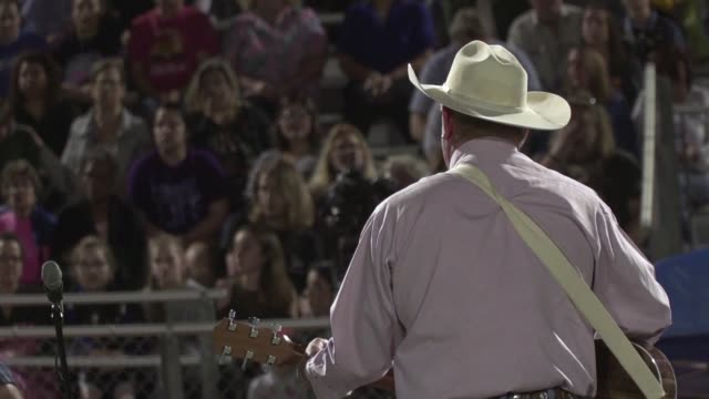 Hundreds of people from La Vernia Texas take part in a religious ceremony to pay tribute to the victims of the Sutherland Springs church shooting