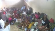 Hundreds of people made homeless by the devastating floods and mudslides in Sierra Leone take refuge in a school where aid agencies try to provide...