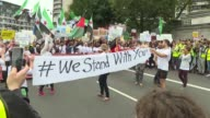 Hundreds of people march in London in support of refugees
