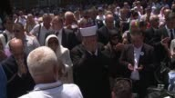 Hundreds of people paid homage Saturday to 127 victims of the Srebrenica massacre in wartime Bosnia whose bodies have been found in mass graves