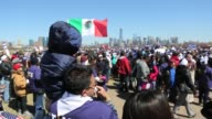 Hundreds of people participate in an immigration reform rally at Liberty Park in Jersey City across the Hudson River from New York City Immigrant...