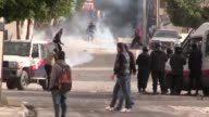 Hundreds of people protested Wednesday in the impoverished central Tunisian city of Kasserine where police fired tear gas to disperse demonstrators...