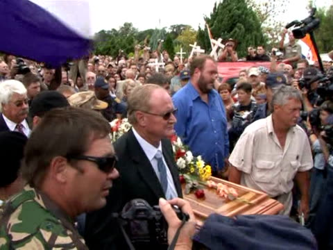 Hundreds of police and rightwing paramilitaries guarded the funeral Friday of murdered South African white supremacist Eugene Terre'Blanche his...