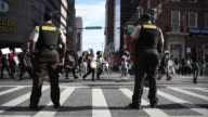 Hundreds of protesters break the city of Baltimore's curfew and several are arrested a day after six police officers were charged over the death of...