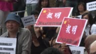 Hundreds of protesters gather outside the headquarters of a Hong Kong newspaper where a respected editor was recently sacked after publishing a front...