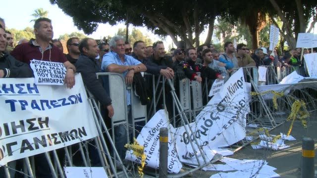 Hundreds of protesters gathered outside the Cyprus parliament on Thursday as a crucial vote was being held on the government's planned selloff of...