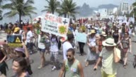 Hundreds of protesters march along the beaches of Rio de Janeiro calling for action against climate change and deforestation