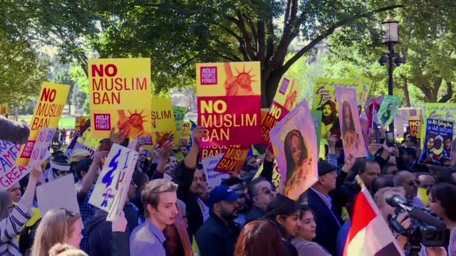 Hundreds of protestors gather outside of the White House to rally against US President Donald Trump's travel bans targeting travelers from majority...