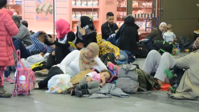 Hundreds of refugees fled from Hungary to Vienna wait at main railway station of Vienna to arrive Germany on 15 September 2015