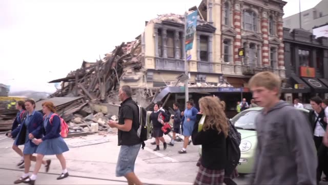 Hundreds of rescuers swarmed over twisted and smoking buildings Wednesday in a frantic search for survivors after New Zealand's catastrophic...