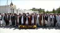 Hundreds of Shiite mourners bury victims of a suicide bomb and gun attack on a mosque in Kabul as the death toll from the atrocity rose to 28