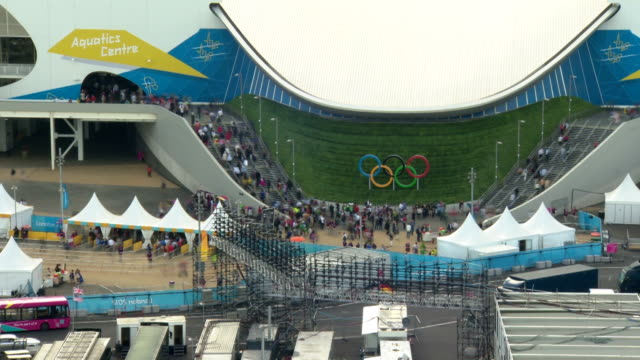 Hundreds of spectators enter this purpose build swimming arena during the London 2012 Olympics Timelapse Aquatics Centre Exterior Day at Olympic Park...