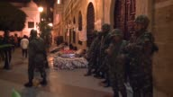 Hundreds of Tunisians defied a nighttime curfew and camped out in front of Prime Minister Mohammed Ghannouchi's office Sunday in a bid to force the...