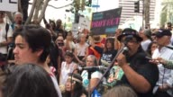 Hundreds rally in front of the Army Corps of Engineers building before marching to Pershing Square in downtown Los Angles SOT Broll