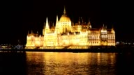 Hungarian Parliament building and Danube river by night